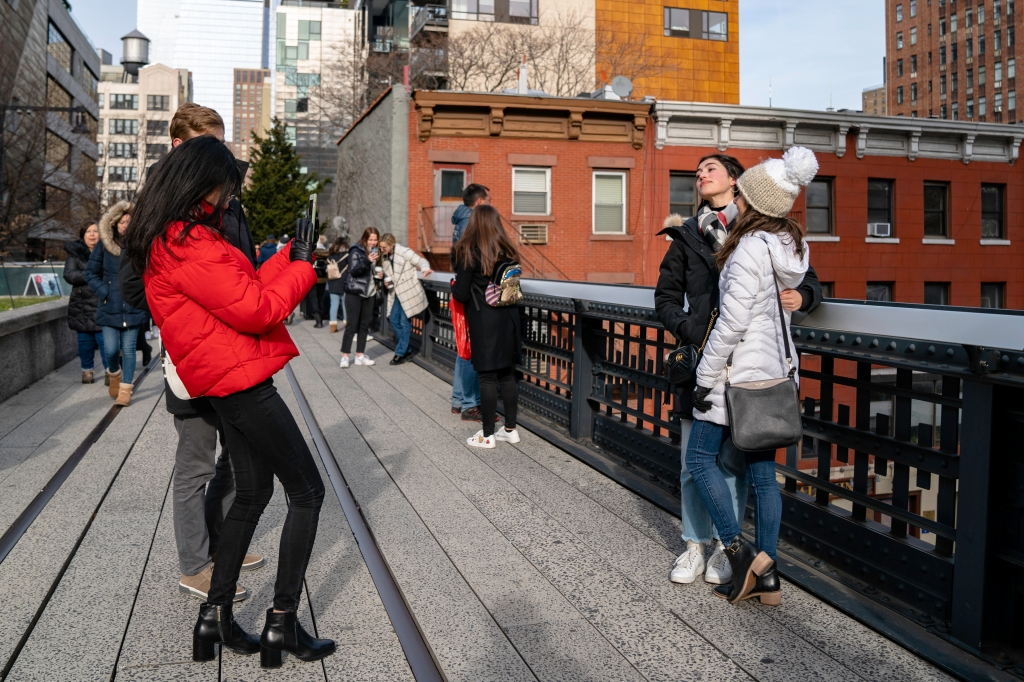 Friends taking portraits on the High Line Park
